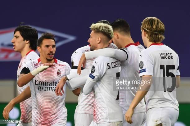 Milan's Spanish midfielder Samuel Castillejo Azuaga celebrates with teammates after scoring a goal during the UEFA Europa League Group H football...