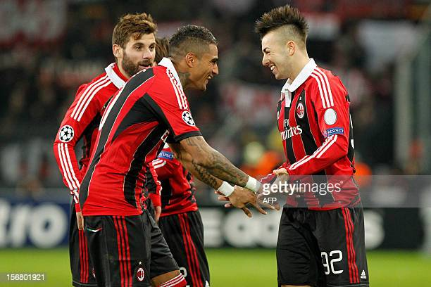 AC Milan's Stephan El Shaarawy celebrates with teammates KevinPrince Boateng after scoring a goal during an UEFA Champions League group C football...