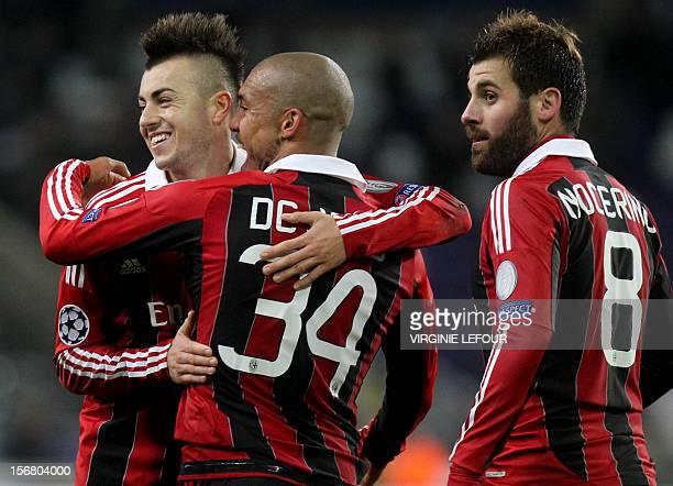 Milan's Stephan El Shaarawy Nigel de Jong and Antonio Nocerino celebrate after winning an UEFA Champions League group C football match between...
