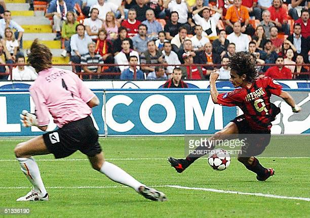 Milan's striker Filippo Inzaghi misses a shot against goalkeeper Marco Storari of Messina during their Italian Serie A match at San Siro stadium in...