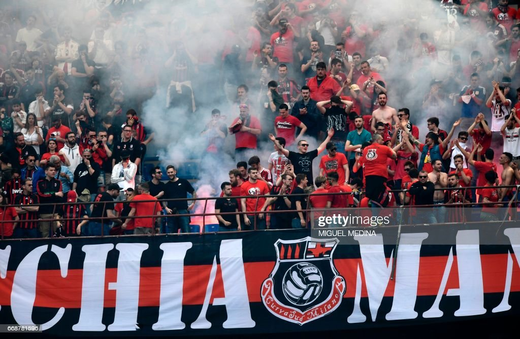AC Milan's supporters celebrate a goal during the Italian Serie A football match Inter Milan vs AC Milan at 'San Siro' Stadium in Milan on April 15, 2017. /