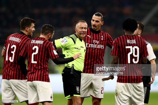 AC Milan's Swedish forward Zlatan Ibrahimovic and AC Milan players contest Italian referee Paolo Valeri's decision to grant a penalty to Juventus...