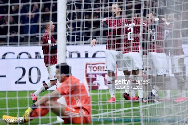 AC Milan's Swedish forward Zlatan Ibrahimovic and teammates celebrate after AC Milan opened the scoring past Juventus' Italian goalkeeper Gianluigi...