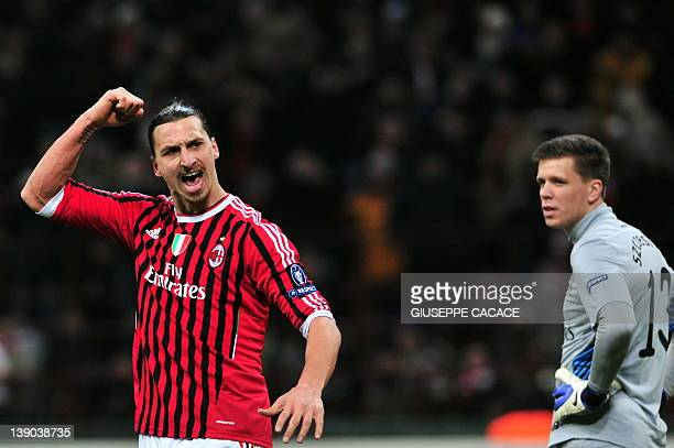 AC Milan's Swedish forward Zlatan Ibrahimovic celebrates after scoring a penalty during the UEFA Champions League round of 16 first leg match AC...