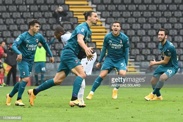 Milan's Swedish forward Zlatan Ibrahimovic celebrates after scoring during the Italian Serie A football match between Udinese and AC Milan at the...