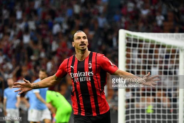 Milans Swedish forward Zlatan Ibrahimovic celebrates after scoring during the Italian Serie A football match between AC Milan and Lazio at The San...