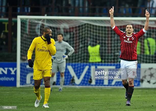 AC Milan's Swedish forward Zlatan Ibrahimovic celebrates after scoring nex to Arsenal's Thierry Henry after scoring during the UEFA Champions League...