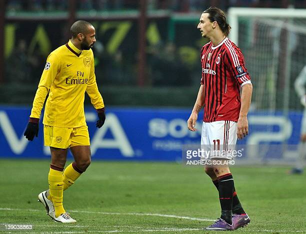 AC Milan's Swedish forward Zlatan Ibrahimovic celebrates after scoring nex to Arsenal's Thierry Henry after scoring during the UEFA Champions League...