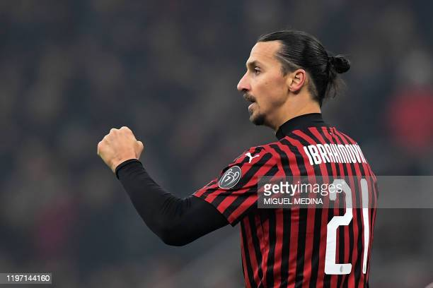 Milan's Swedish forward Zlatan Ibrahimovic celebrates scoring his team's fourth goal during the Italian Cup round of 8 football match between AC...
