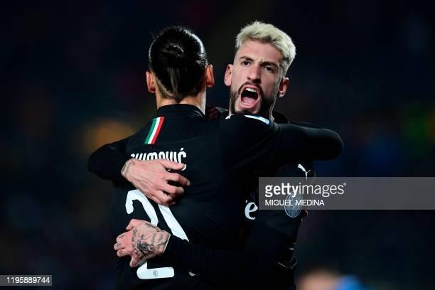 AC Milan's Swedish forward Zlatan Ibrahimovic celebrates with AC Milan's Spanish forward Samu Castillejo after AC Milan's Croatian forward Ante Rebic...