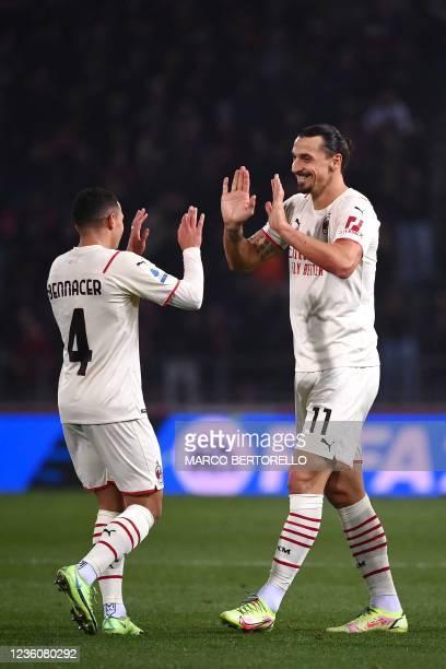 Milan's Swedish forward Zlatan Ibrahimovic celebrates with AC Milan's Algerian midfielder Ismael Bennacer after scoring during the Italian Serie A...