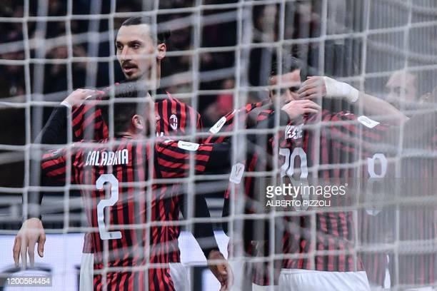 Milan's Swedish forward Zlatan Ibrahimovic celebrates with teammates after AC Milan opened the scoring during the Italian Cup semi-final first leg...