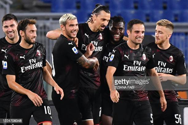 AC Milan's Swedish forward Zlatan Ibrahimovic celebrates with teammates after scoring a penalty during the Italian Serie A football match Lazio vs AC...