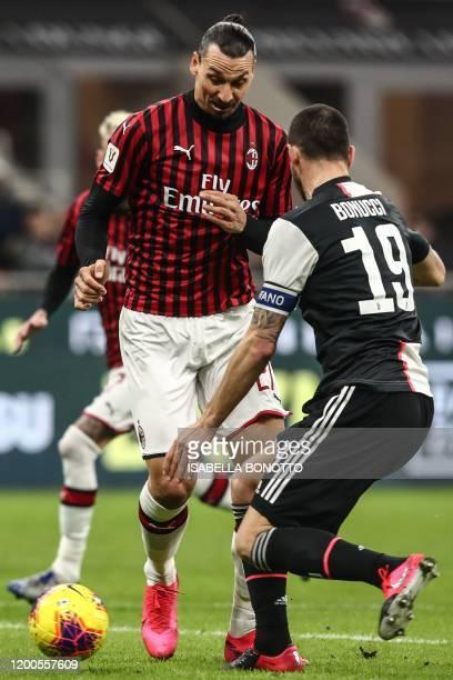 Milan's Swedish forward Zlatan Ibrahimovic challenges Juventus' Italian defender Leonardo Bonucci during the Italian Cup semi-final first leg...