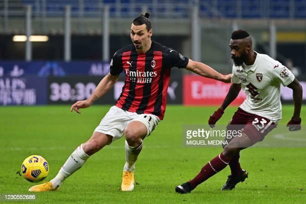 Milan's Swedish forward Zlatan Ibrahimovic challenges Torino's Cameroon defender Nicolas Nkoulou during the Italian Cup round of sixteen football...