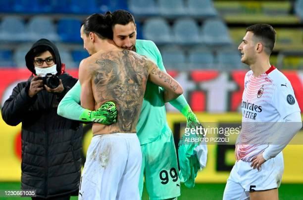Milan's Swedish forward Zlatan Ibrahimovic embraces AC Milan's Italian goalkeeper Gianluigi Donnarumma at the end of the Italian Serie A football...