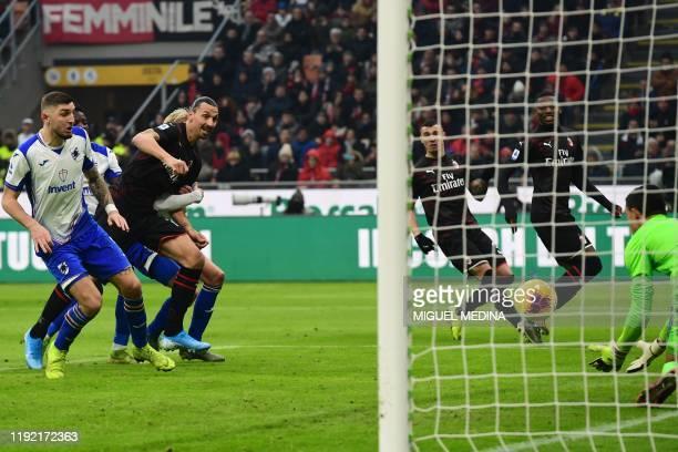 AC Milan's Swedish forward Zlatan Ibrahimovic eyes the ball after heading a shot during the Italian Serie A football match AC Milan vs Sampdoria on...