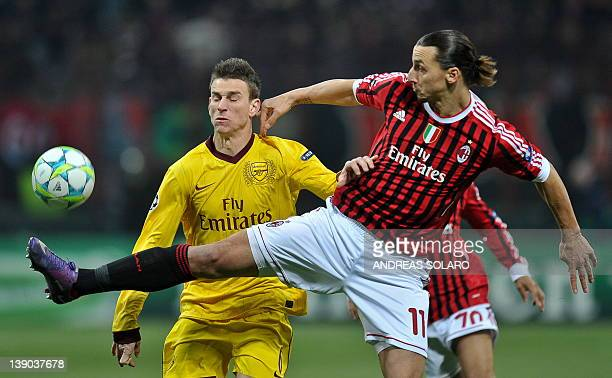 AC Milan's Swedish forward Zlatan Ibrahimovic fights for the ball against Arsenal's French player Laurent Koscielny during the UEFA Champions League...