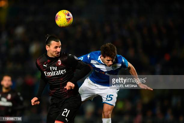AC Milan's Swedish forward Zlatan Ibrahimovic fights for the ball with Brescia's Italian defender Andrea Cistana during the Italian Serie A football...
