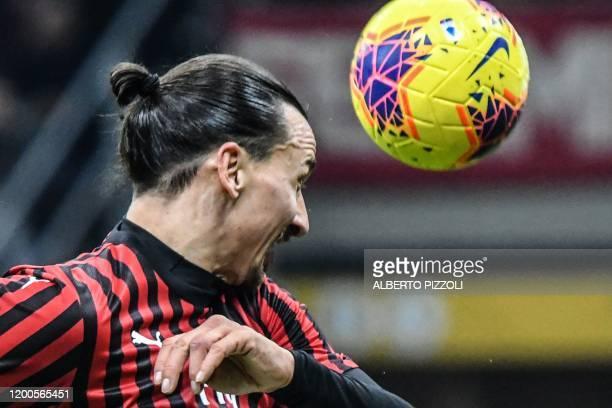Milan's Swedish forward Zlatan Ibrahimovic goes for a header during the Italian Cup semi-final first leg football match AC Milan vs Juventus Turin on...