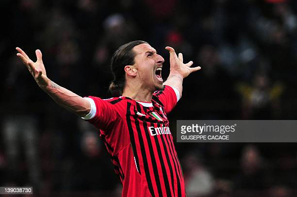 AC Milan's Swedish forward Zlatan Ibrahimovic kicks and score a penalty during the UEFA Champions League round of 16 first leg match AC Milan vs...