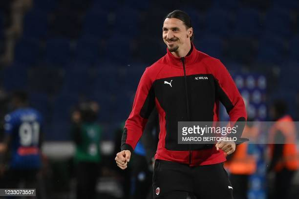 Milan's Swedish forward Zlatan Ibrahimovic reacts after AC Milan secured their qualification for the Champions League at the end of the Italian Serie...