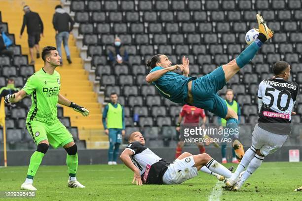 Milan's Swedish forward Zlatan Ibrahimovic shoots and scores during the Italian Serie A football match between Udinese and AC Milan at the Friuli...