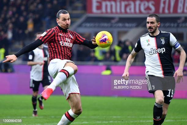 AC Milan's Swedish forward Zlatan Ibrahimovic shoots on goal despite Juventus' Italian defender Leonardo Bonucci during the Italian Cup semifinal...