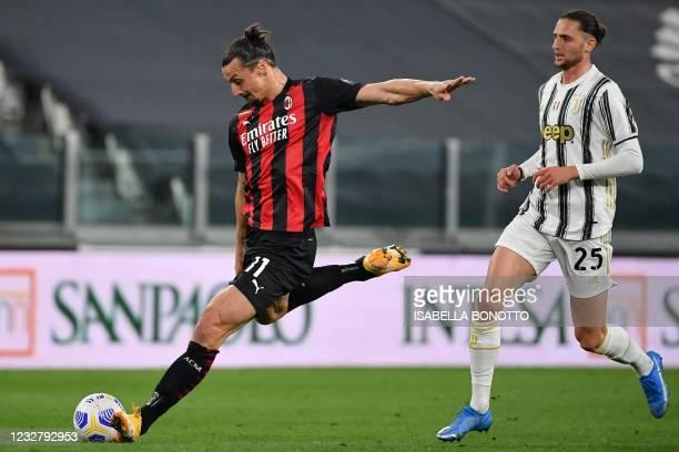 Milan's Swedish forward Zlatan Ibrahimovic shoots on target ahead of Juventus' French midfielder Adrien Rabiot during the Italian Serie A football...