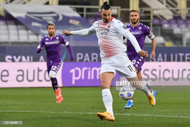 Milan's Swedish forward Zlatan Ibrahimovic shoots to open the scoring during the Italian Serie A football match Fiorentina vs AC Milan on March 21,...