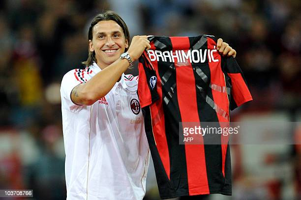 AC Milan's Swedish forward Zlatan Ibrahimovic show his jersey during his presentation the Serie A football match AC Milan vs Lecce at San Siro...