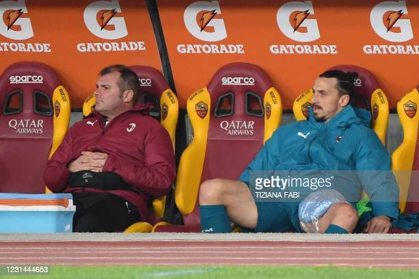 Milan's Swedish forward Zlatan Ibrahimovic sits on the substitutes' bench with an ice pack on his left tigh, after being injured during the Italian...