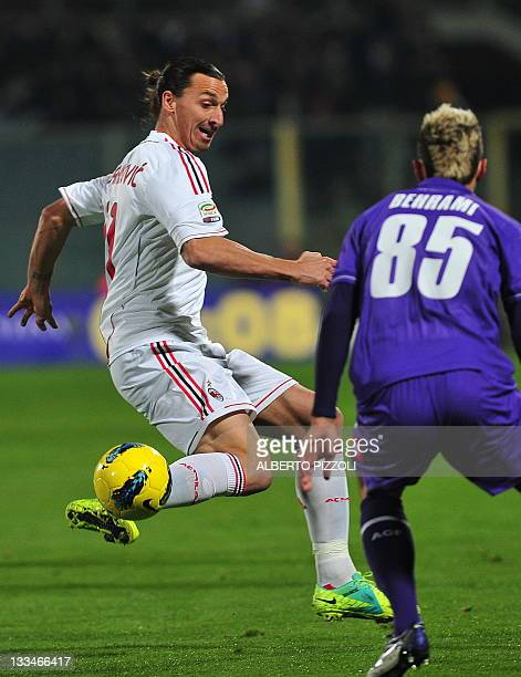 Milan's Swedish forward Zlatan Ibrahimovic vies for the ball with Fiorentina's midfieleder Valon Behrami from Kossovo during the Italian A series...