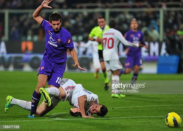 Milan's Swedish forward Zlatan Ibrahimovic vies for the ball with Fiorentina's defender Serbian Matija Nastasic during the Italian A series football...