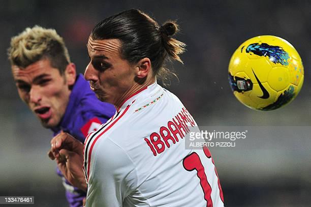 Milan's Swedish forward Zlatan Ibrahimovic vies with Fiorentina's Kosovan midfieleder Valon Behrami during their Italian serie A football match at...