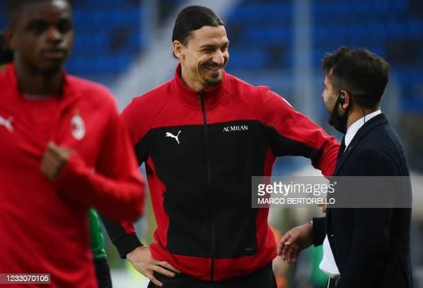 Milan's Swedish forward Zlatan Ibrahimovic, who doesn't play following an injury, attends the Italian Serie A football match Atalanta Bergamo vs AC...