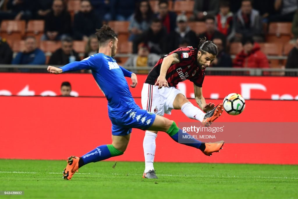 AC Milan's Swiss defender Ricardo Rodriguez 2vies with Sassuolo's Spanish defender Pol Lirola during the Italian Serie A football match AC Milan vs Sassuolo at the San Siro stadium in Milan on April 8, 2018. /