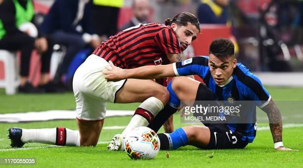 AC Milan's Swiss defender Ricardo Rodriguez and Inter Milan's Argentinian forward Lautaro Martinez go for the ball during the Italian Serie A...
