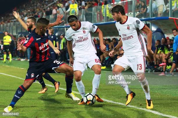Milan's Swiss defender Ricardo Rodriguez and Milan's Italian midfielder Manuel Locatelli vie for the ball with Crotone's Italian defender Davide...