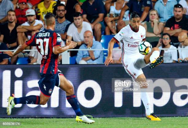 Milan's Swiss defender Ricardo Rodriguez controls the ball near Crotone's Italian defender Davide Faraoni during the Italian Serie A football match...