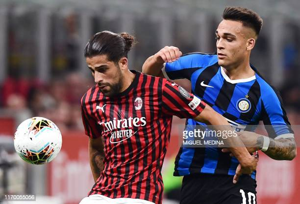 AC Milan's Swiss defender Ricardo Rodriguez holds off Inter Milan's Argentinian forward Lautaro Martinez during the Italian Serie A football match AC...