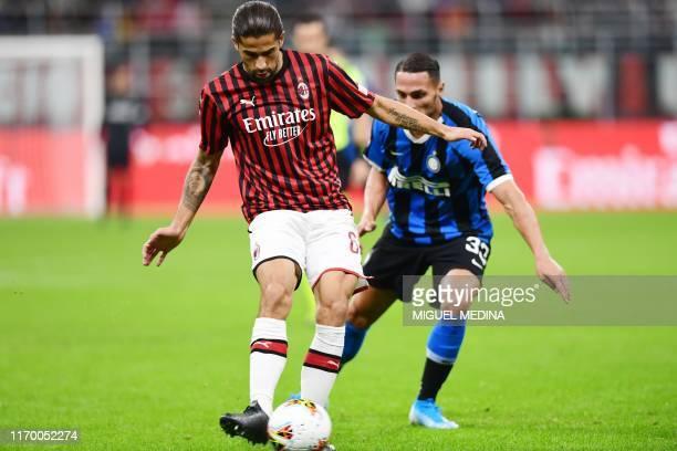 AC Milan's Swiss defender Ricardo Rodriguez passes the ball under presssure from Inter Milan's Italian defender Danilo D'Ambrosio during the Italian...