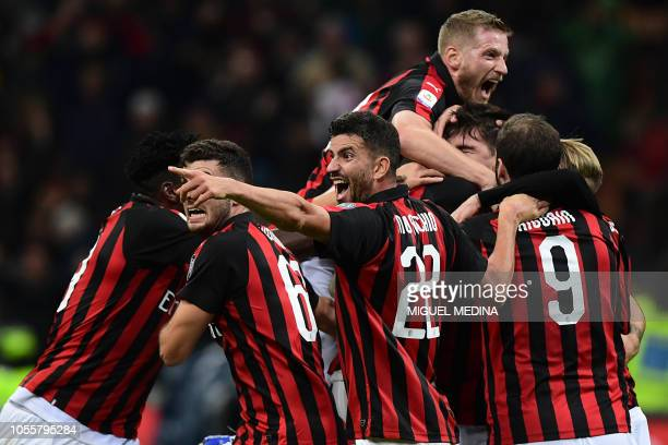 AC Milan's teamplayers congratulate AC Milan's Italian defender Alessio Romagnoli after scoring a goal during the Italian Serie A football match...