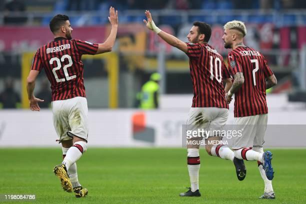 AC Milan's Turkish forward Hakan Calhanoglu celebrates after scoring during the Italian Serie A football match AC Milan vs Verona on February 2 2020...