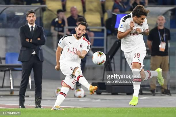 AC Milan's Turkish forward Hakan Calhanoglu kicks the ball during the Italian Serie A football match between AS Roma and AC Milan on October 27 2019...