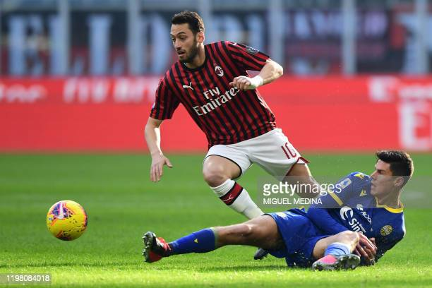 AC Milan's Turkish forward Hakan Calhanoglu outruns Verona's Italian midfielder Matteo Pessina during the Italian Serie A football match AC Milan vs...