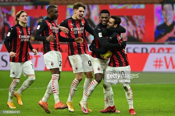 Milan's Turkish midfielder Hakan Calhanoglu celebrates with AC Milan's Portuguese forward Rafael Leao, AC Milan's Italian midfielder Giacomo Olzer,...