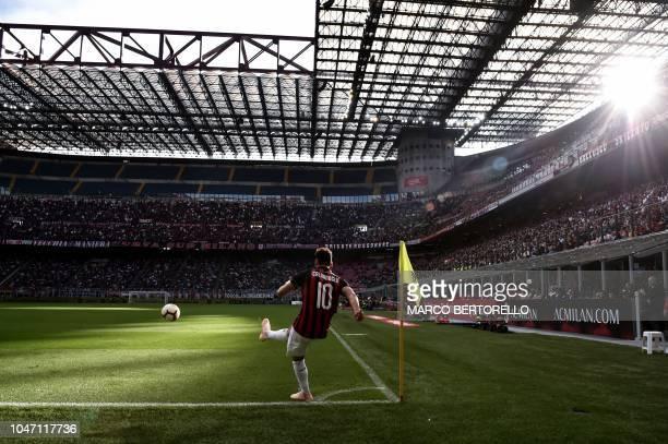 AC Milan's Turkish midfielder Hakan Calhanoglu kicks the ball during the Italian Serie A football match between AC Milan and Chievo Verona on October...