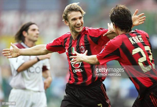 Milan's Ukrainian forward Andreiy Shevchenko celebrates his second goal congratulated by Brazilian teammate Kaka during their Italian Serie A...