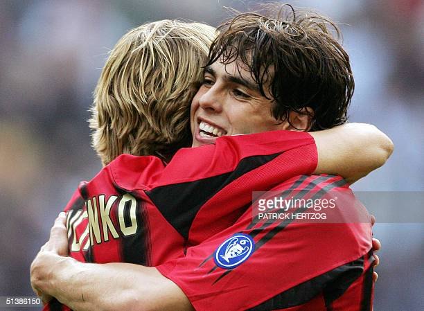 Milan's Ukrainian forward Andreiy Shevchenko is congratulated by Brazilian teammate Kaka after scoring his second goal against Reggina during their...